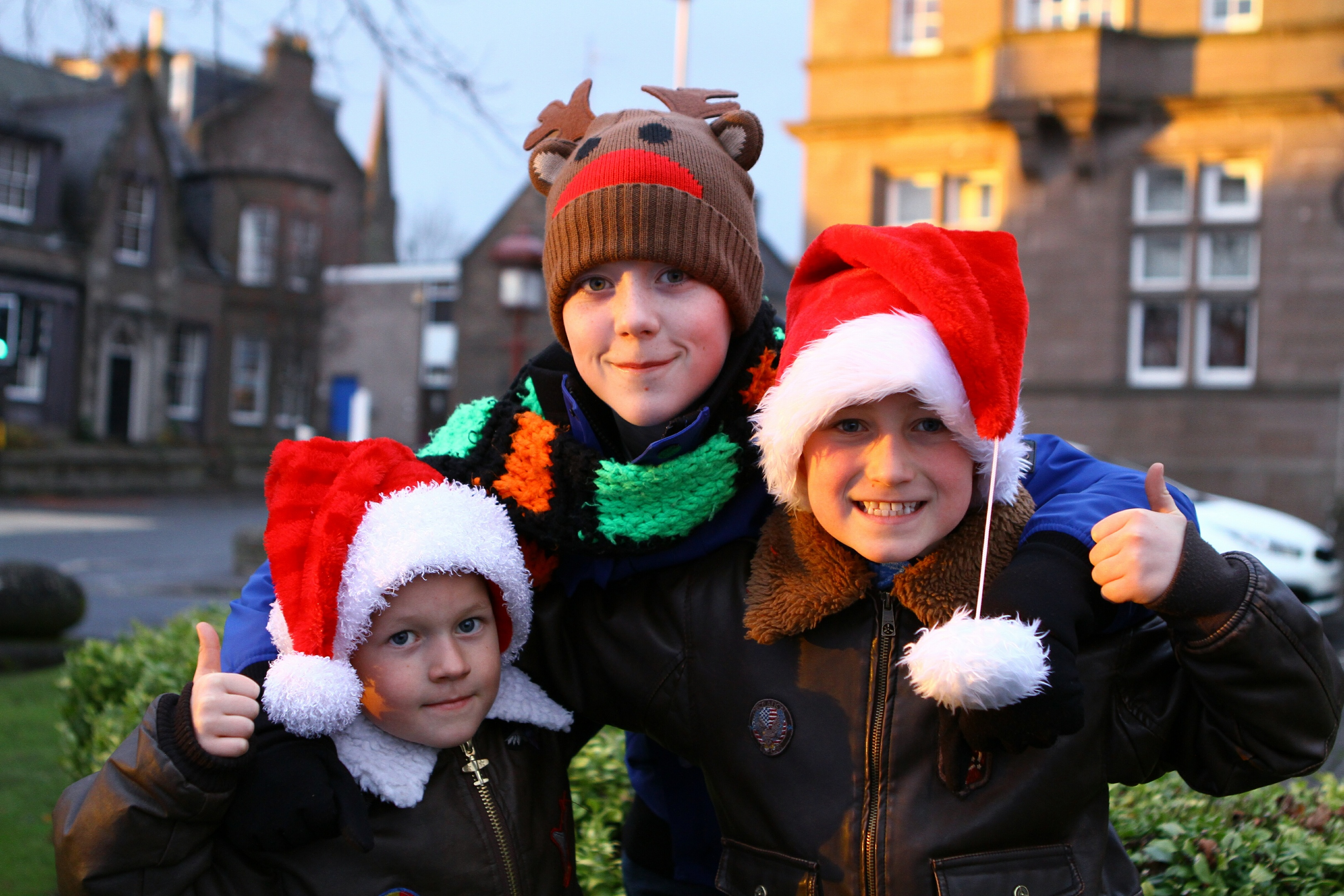 William McDonald, 6, Alex McFarlane, 12, and Andrew McDonald, 8,  at the Brechin Christmas lights event.