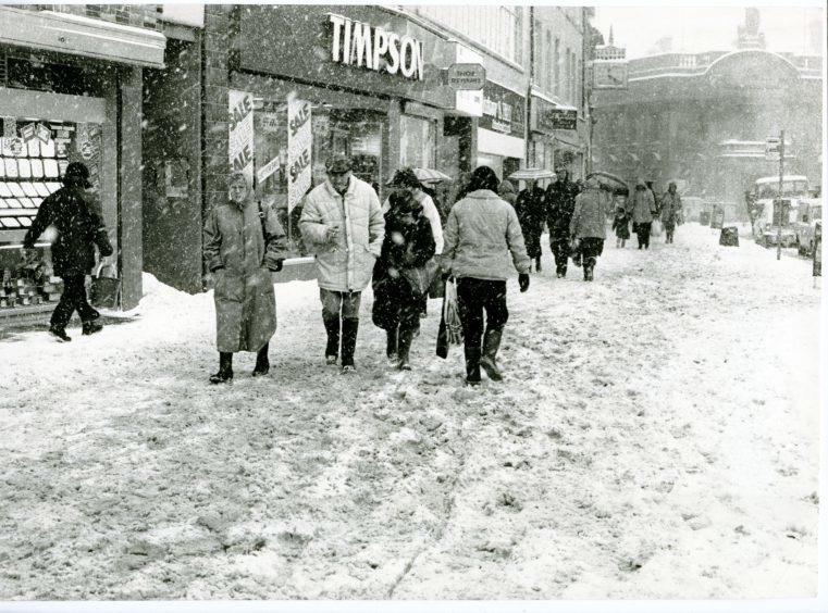 Photograph showing pedestrians as they brave the arctic conditions in Dundee City Centre. 12 January 1987.