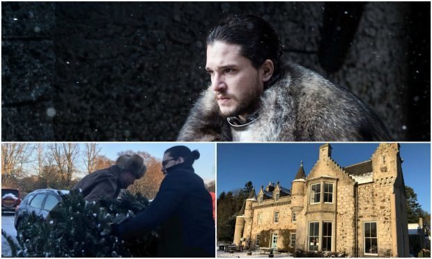 Kit Harington was photographed helping people with their Christmas trees in Aberdeenshire.