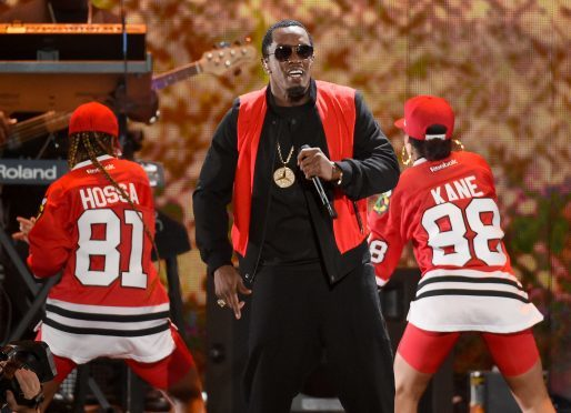"""Recording artist Sean """"Diddy"""" Combs performs with dancers."""