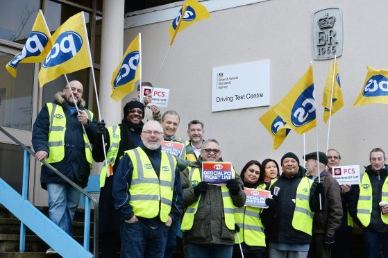 A group of driving examiners on a picket line outside the driving test centre in Barnet, north London yesterday