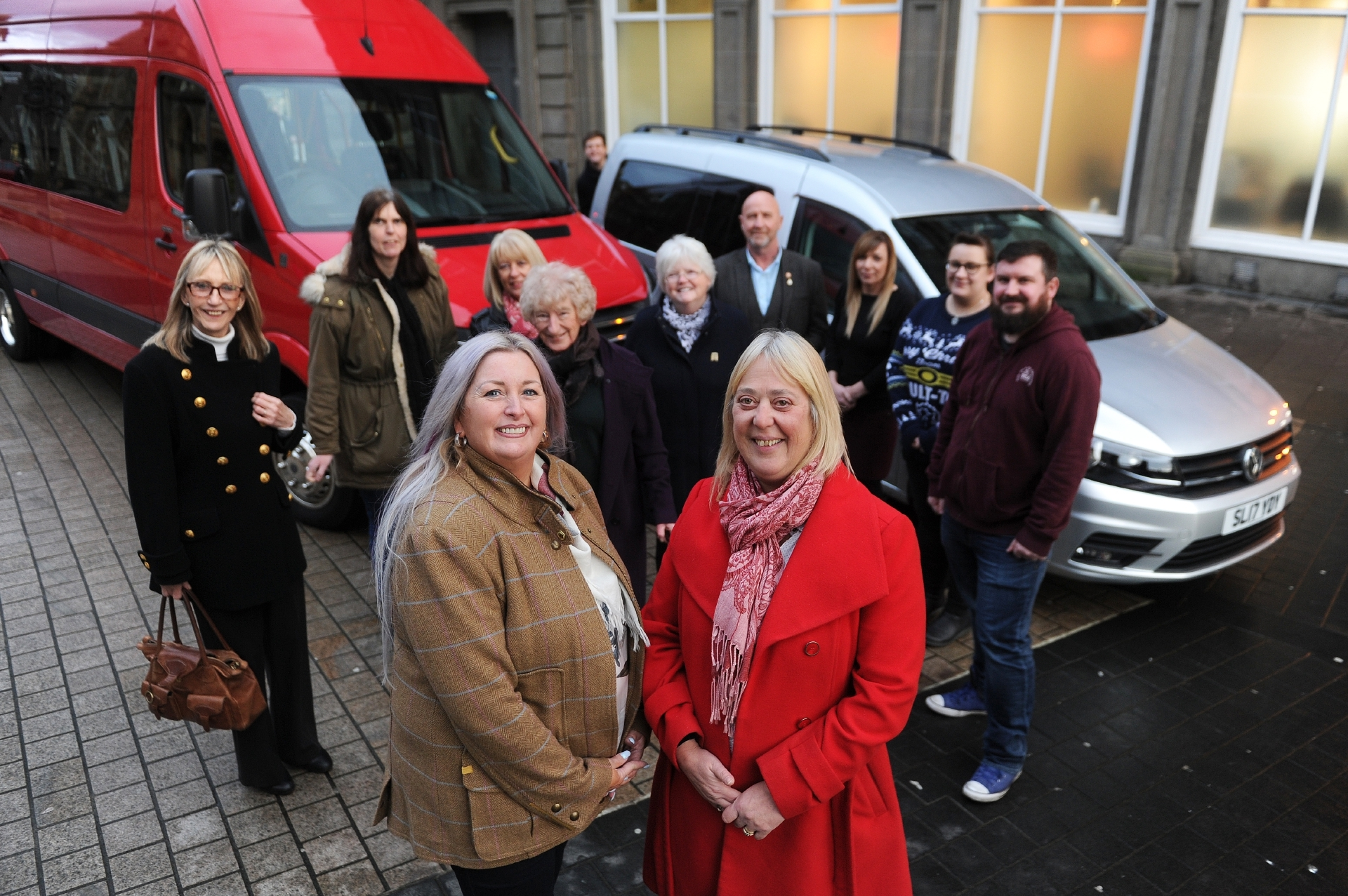 Staff, volunteers and members of the Inclusion Group with the new vehicles donated by Gillian Bayford. Centre L-R Gillan Bayford and Inclusion Group manager Fiona Flynn.