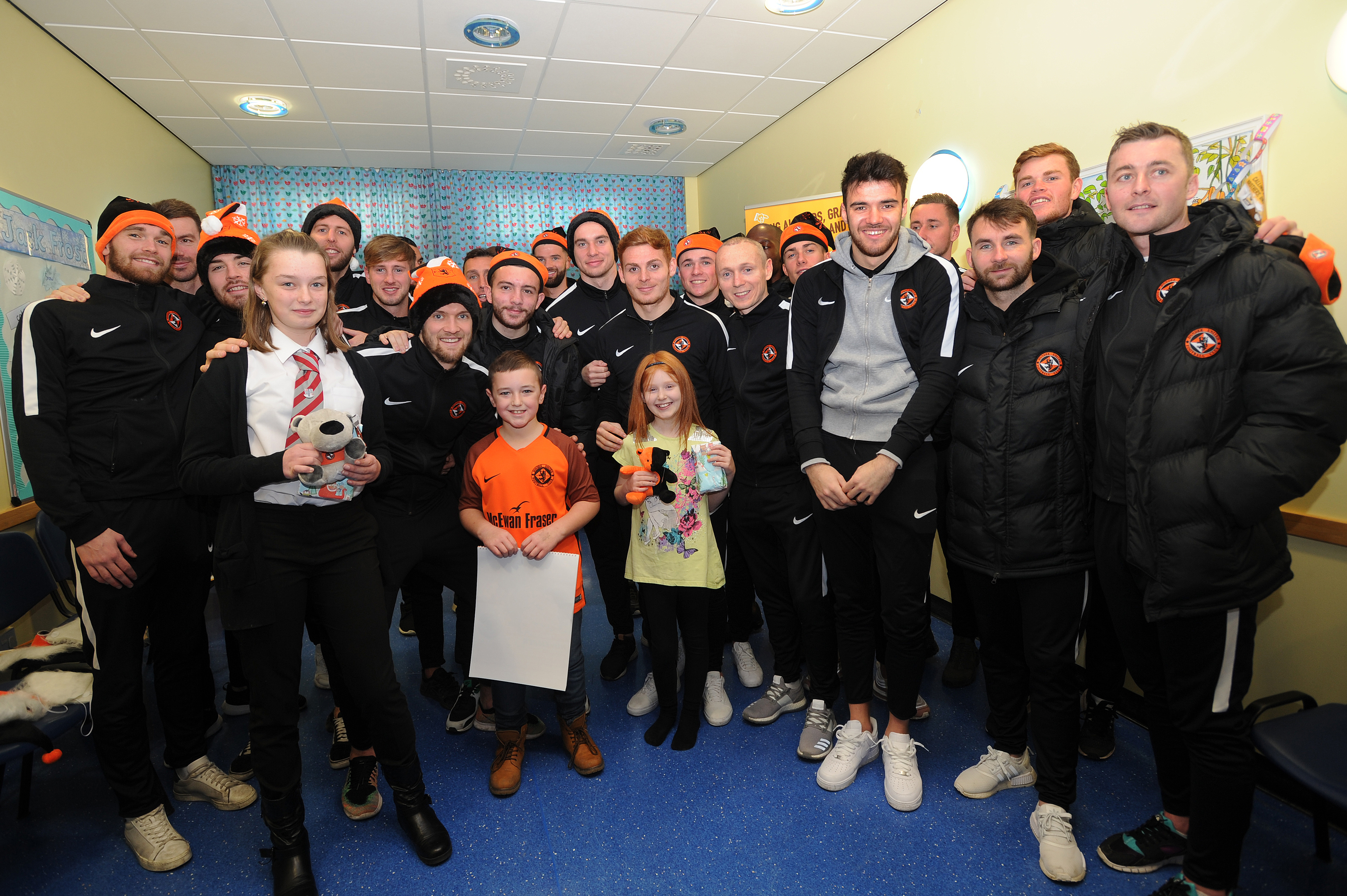 Dundee United players visiting children in the Tayside Children's Hospital.