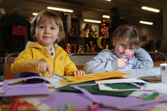 David Ibbotson (3 1/2) and Joan Lily Scappaticcio (6 1/2) enjoy some craft activities at the market,