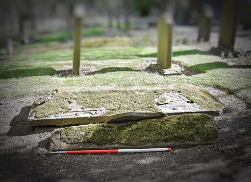 The stone was found during digital mapping of the cemetery in July