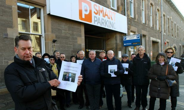 Murdo Fraser MSP with some of those penalised by Smart Parking launching his Holyrood members bill on private parking firms, outside the car park on Kinnoull Street in Perth.