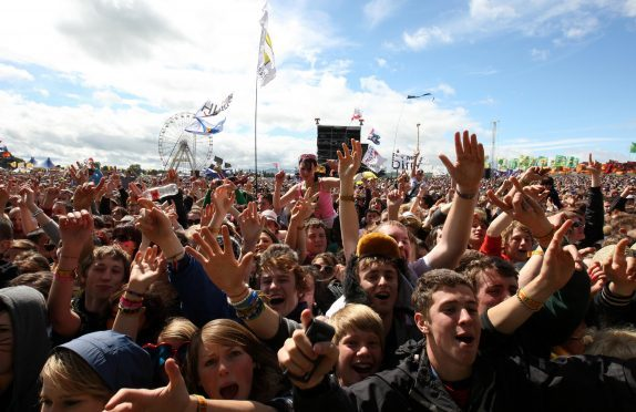 Revellers listen to Dundee band The View at the T in the Park music festival at Balado, Kinross-shire, in 2010