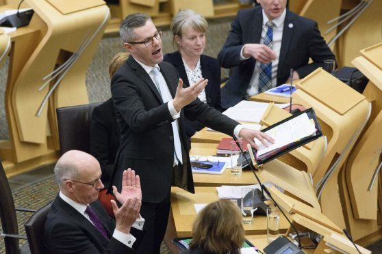 Finance Secretary Derek Mackay delivering his draft Budget for 2018-19 to the Scottish Parliament