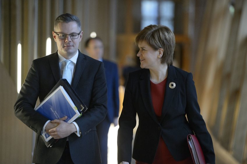 First Minister Nicola Sturgeon and Finance Secretary Derek Mackay arrive to deliver his draft Budget for 2018-19 at the Scottish Parliament.