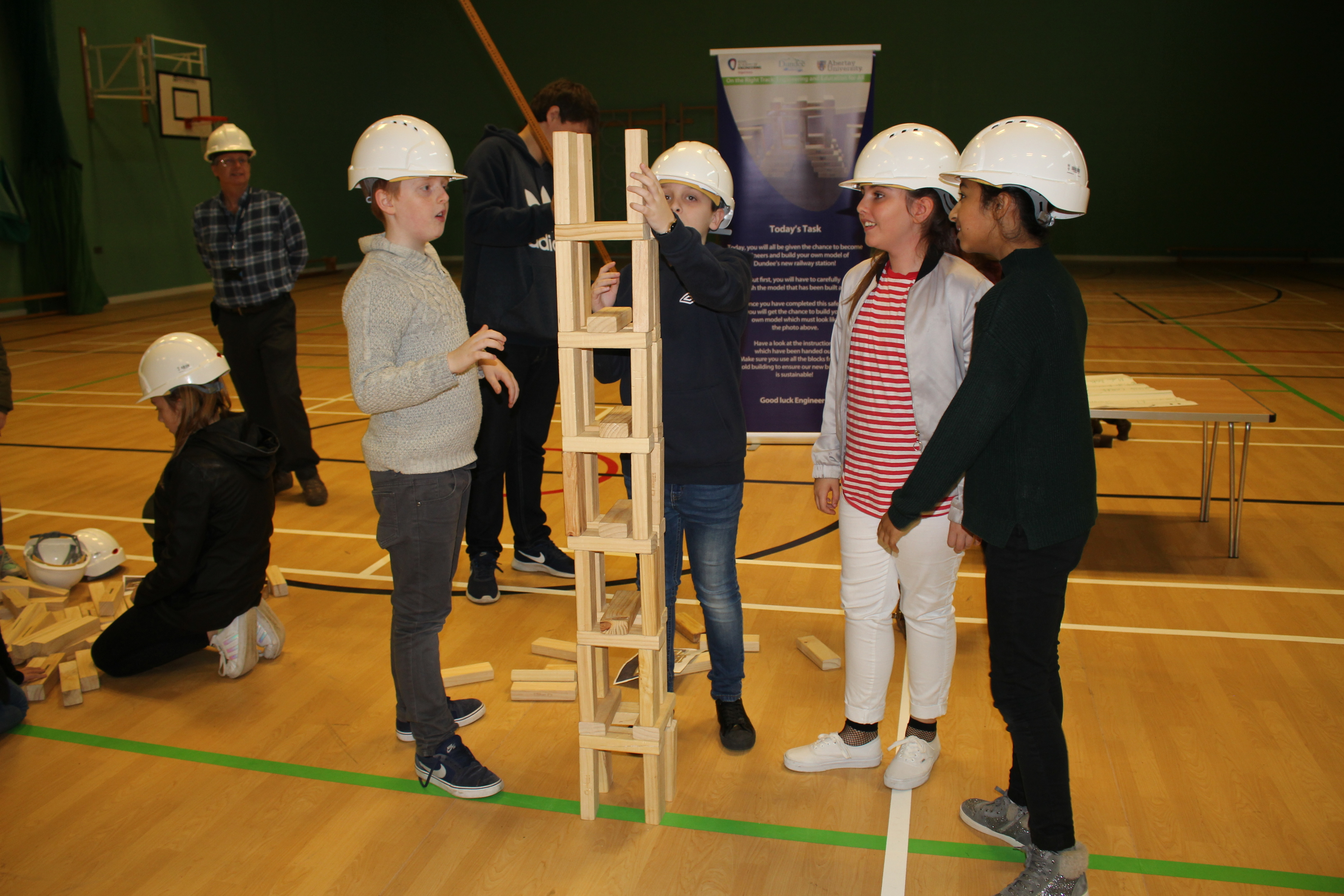 Children from St Peter and Paul's Primary School taking part in the infrastructure project (tower building) during Fife Science Festival at Craigowl PS