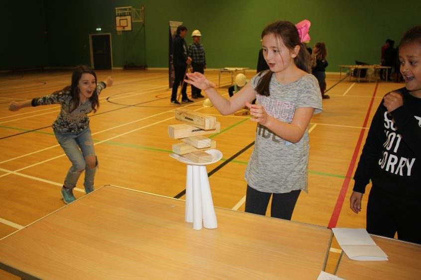 Children from St Peter and Paul's Primary School taking part in the infrastructure project (tower building) during Fife Science Festival at Craigowl PS.