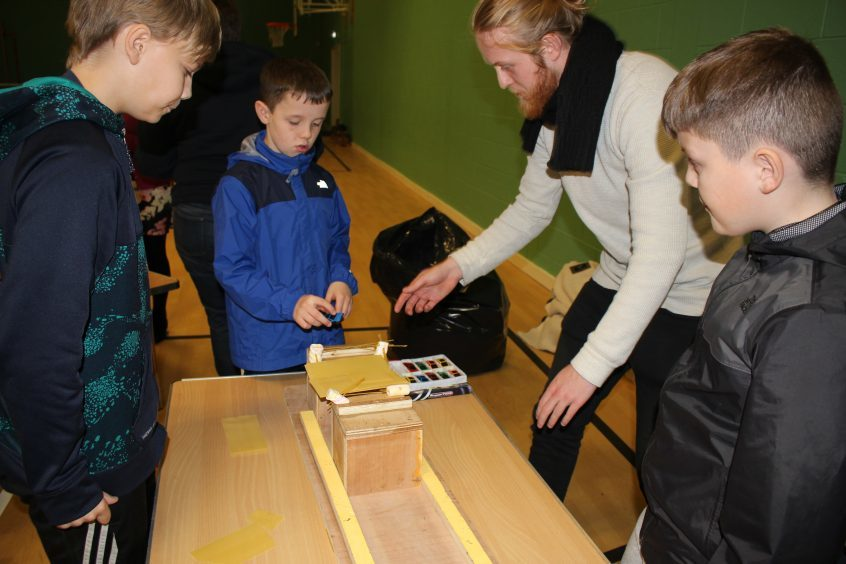 RAE5: Abertay 3rd Year Civil Engineering student Marcus Jensen helps St Peter and Pauls Primary School children construct a bridge using spaghetti and marshmallows during Fife Science Festival at Craigowl PS.