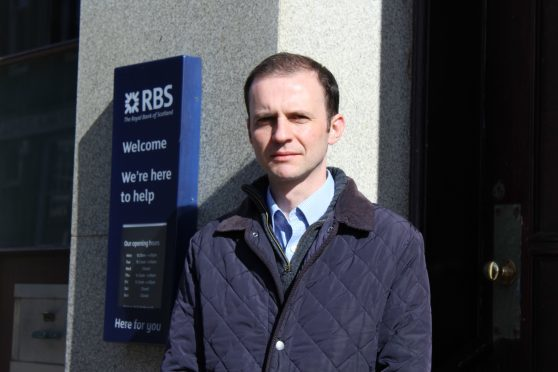 Stephen Gethins outside the Anstruther branch of RBS.