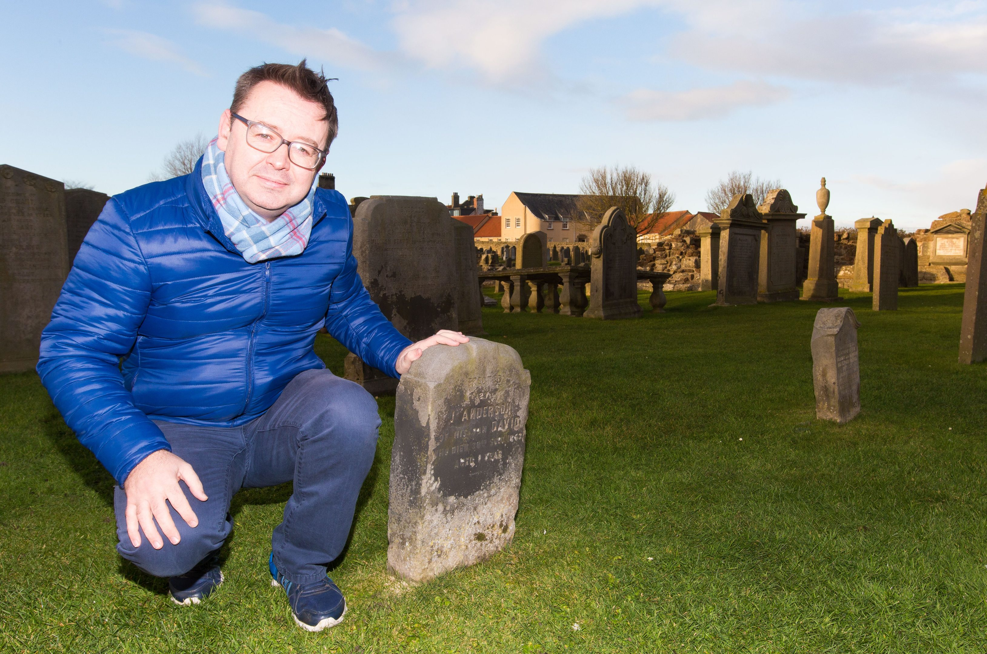 Roger McStravick with the existing gravestone erected following the death of Jamie Anderson's son.