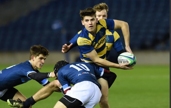 Man of the Match Angus Vipond of Strathallan is tackled by Glenalmond's Rafe Houston at Murrayfield.