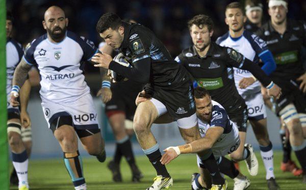Leonardo Sarto busts through for Glasgow's first try.
