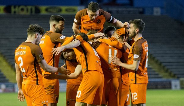 United players celebrate with goalscorer Billy King.