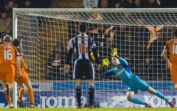 Craig Samson saves the Paul McMullan penalty.