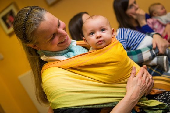 Mum Maren Dralle and baby Hanne-Lotte attend a Dundee Sling Library meeting.