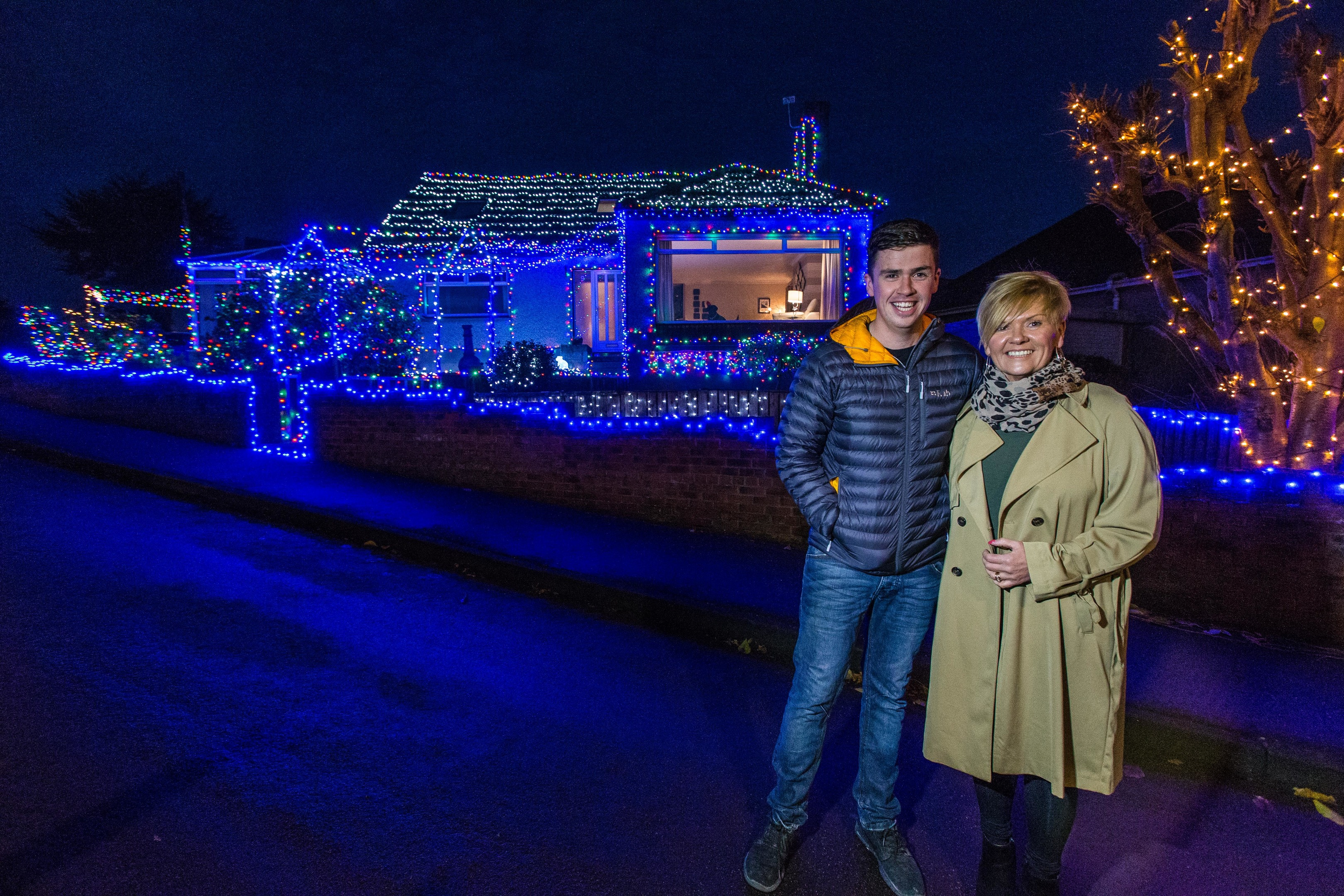 Aileen Simpson and son Fraser Simpson outside their decorated home in Coldstream Crescent, Leven.