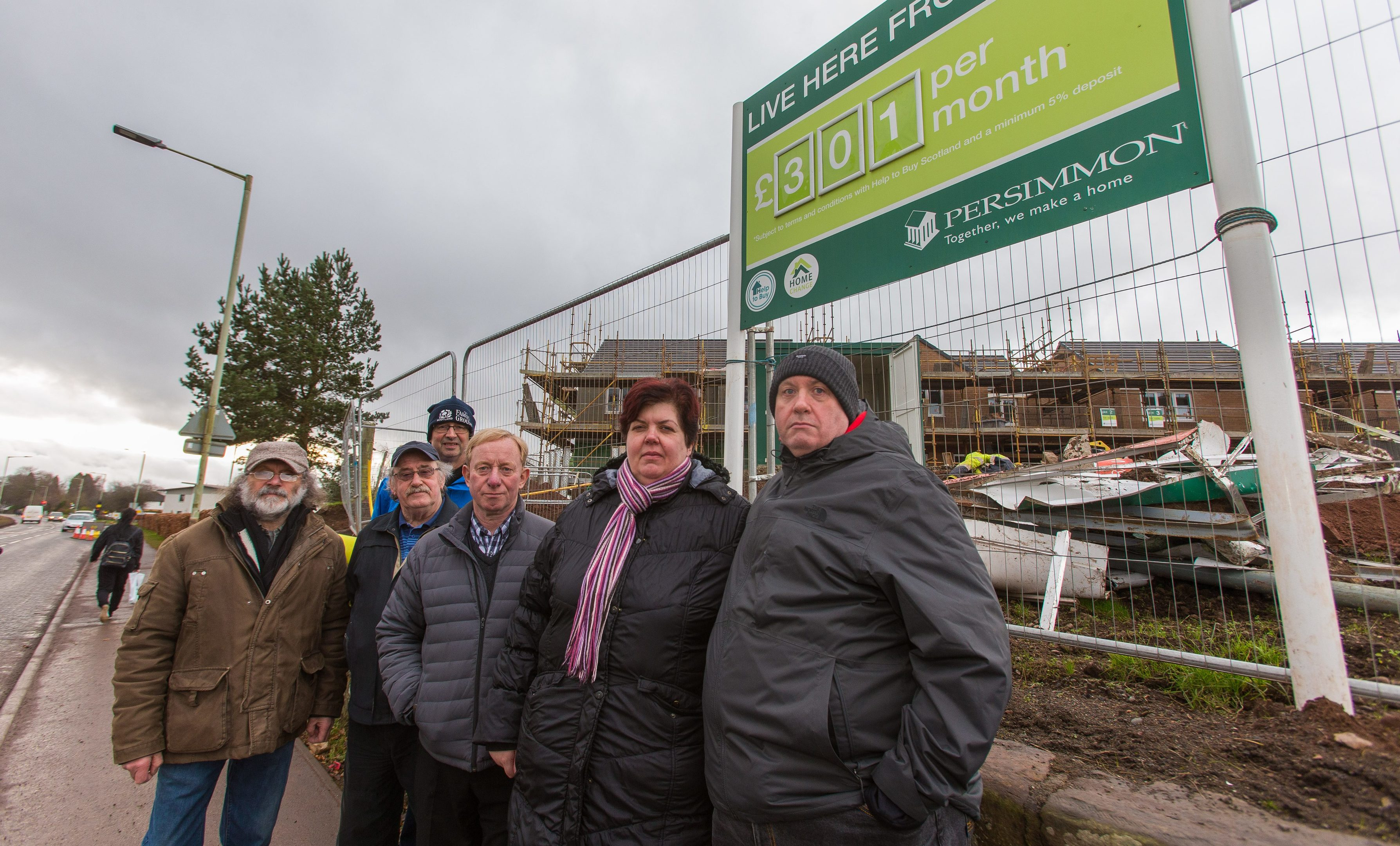 Councillor Willie Robertson in the centre outside the Lathro Meadows site with disgruntled locals.