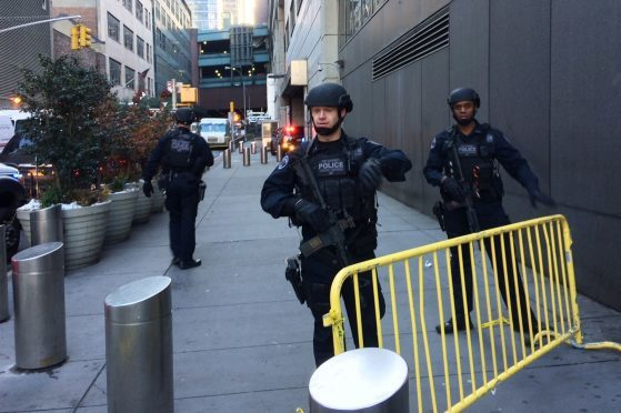 Police block off a sidewalk while responding to a report of an explosion near Times Square.