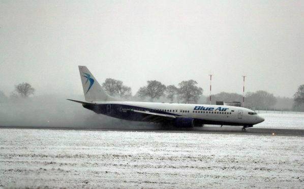 A flight at Luton Airport affected by snow in December 2017.