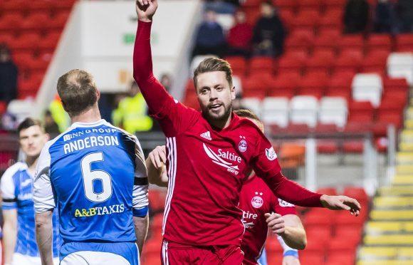 Aberdeen's Kari Arnason celebrates his goal.