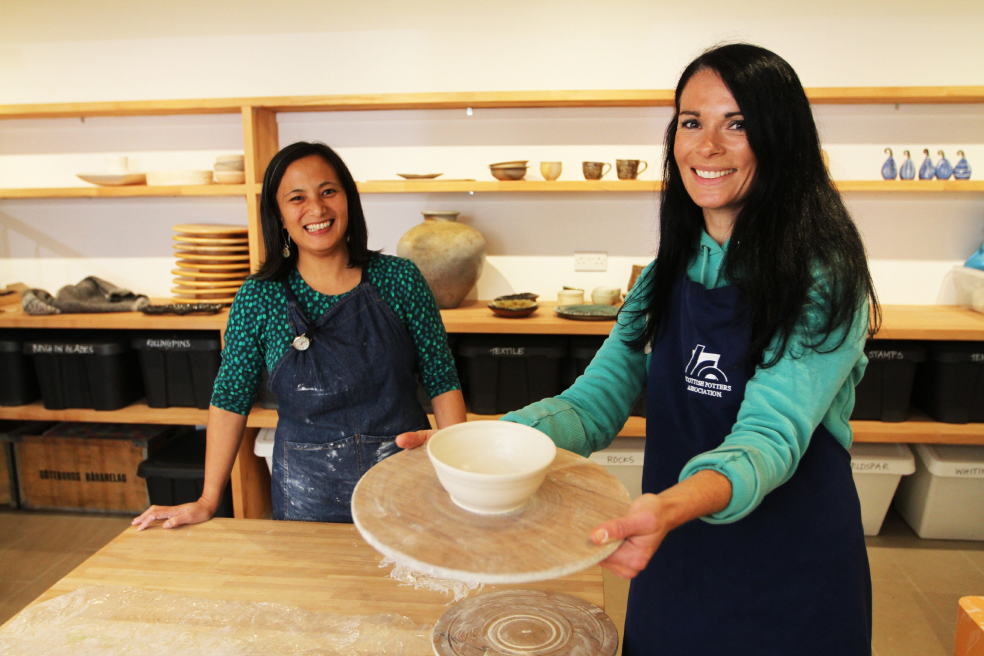 Potter Nancy Fuller with Gayle and the pot she made at Momentum Pottery in Alyth.