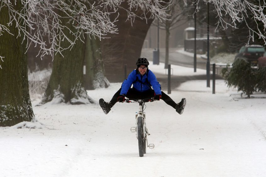 A cyclist in North Inch during snow, December 2009.