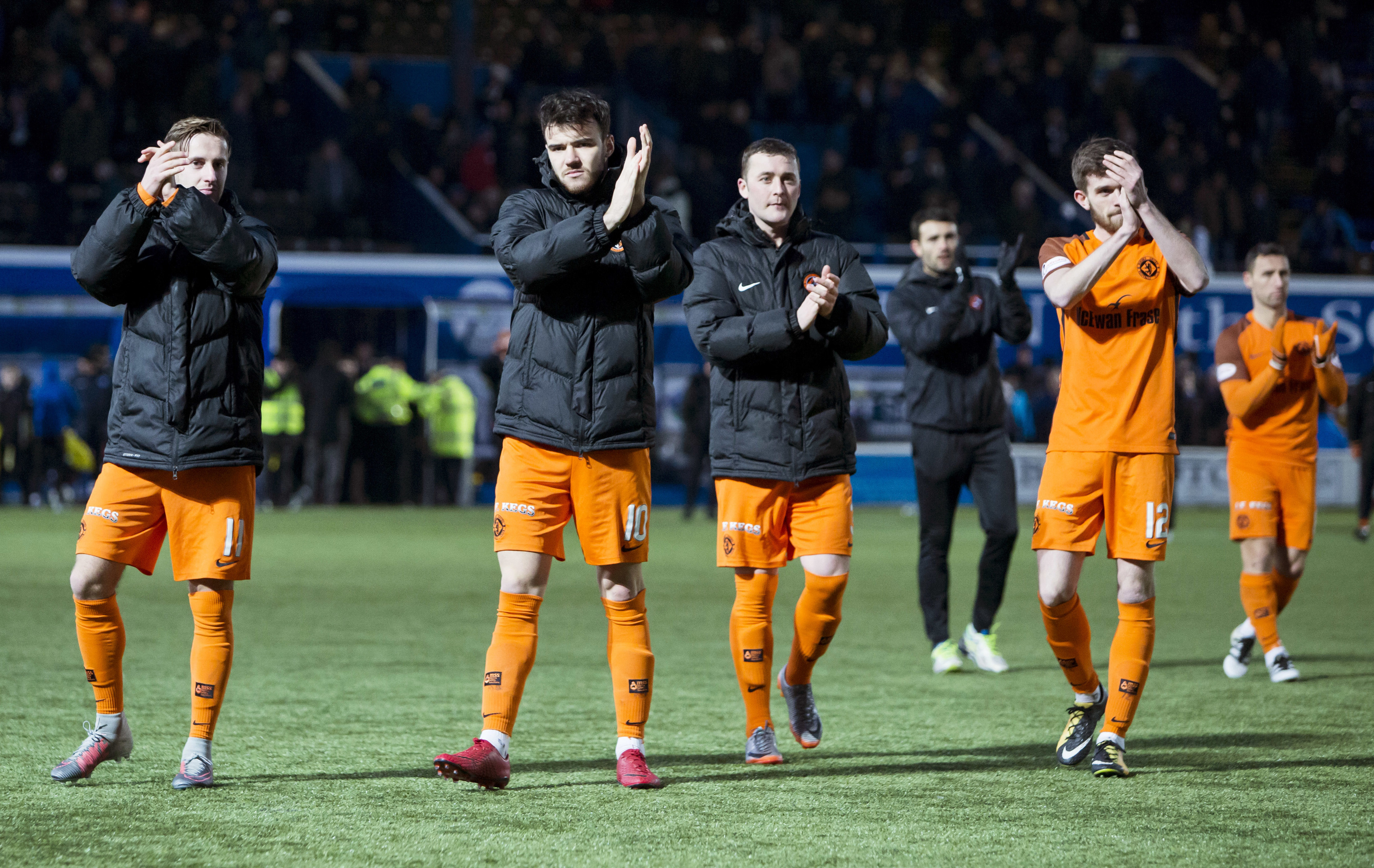 The Dundee United players on the pitch after the match is abandoned.