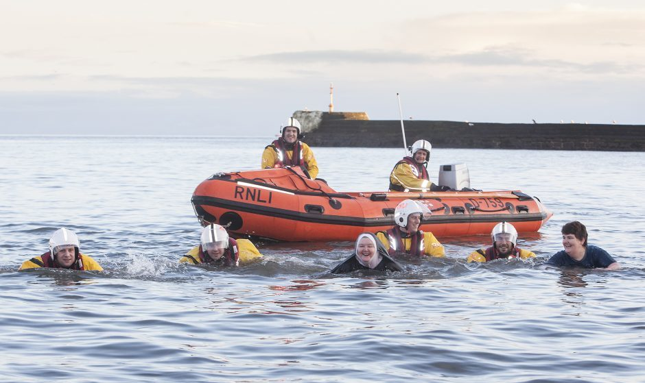 Sandra Michie from Carnoustie swimming with the RNLI at the Arbroath dook.