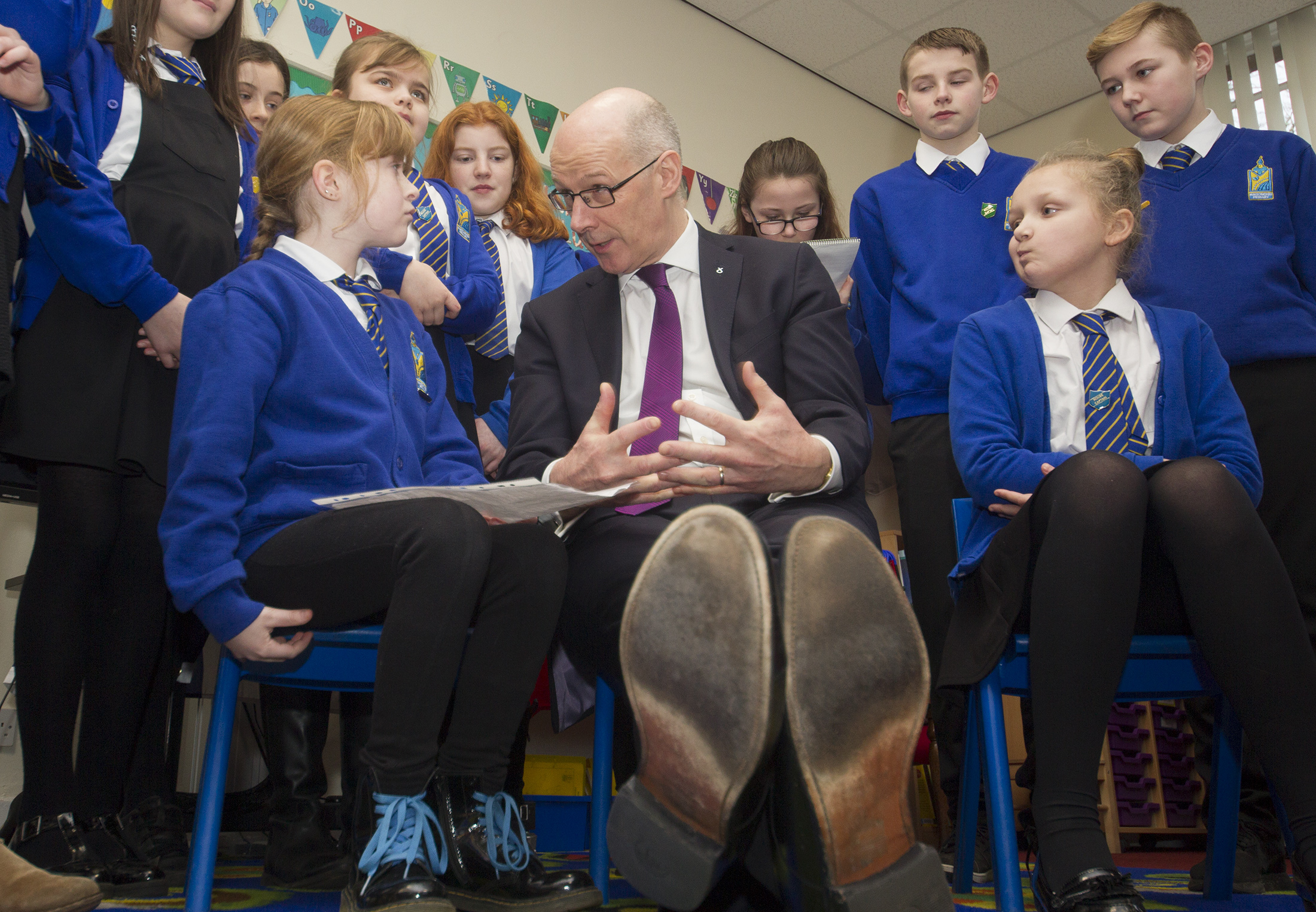 Maisondieu Primary School pupil Lexi Short (left) questions Deputy First Minister John Swinney.