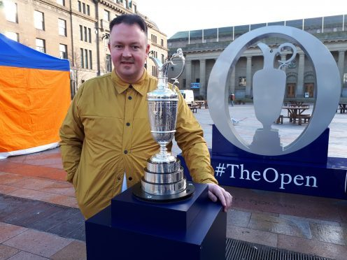 Stephen Rollo posing with the Claret Jug.