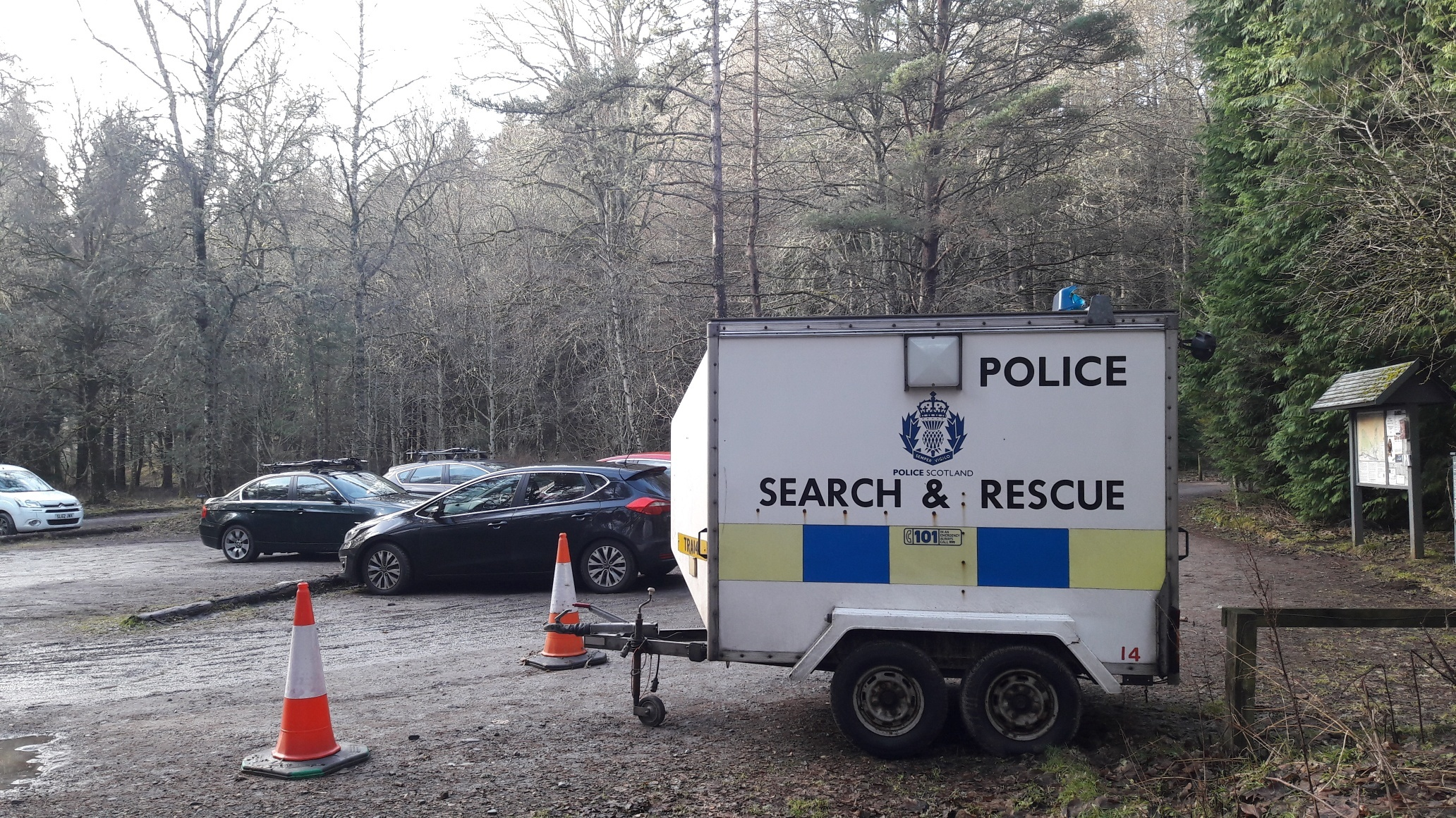 Police search and rescue crews found a vehicle belonging to one of the missing walkers at the Glen Tilt car park.
