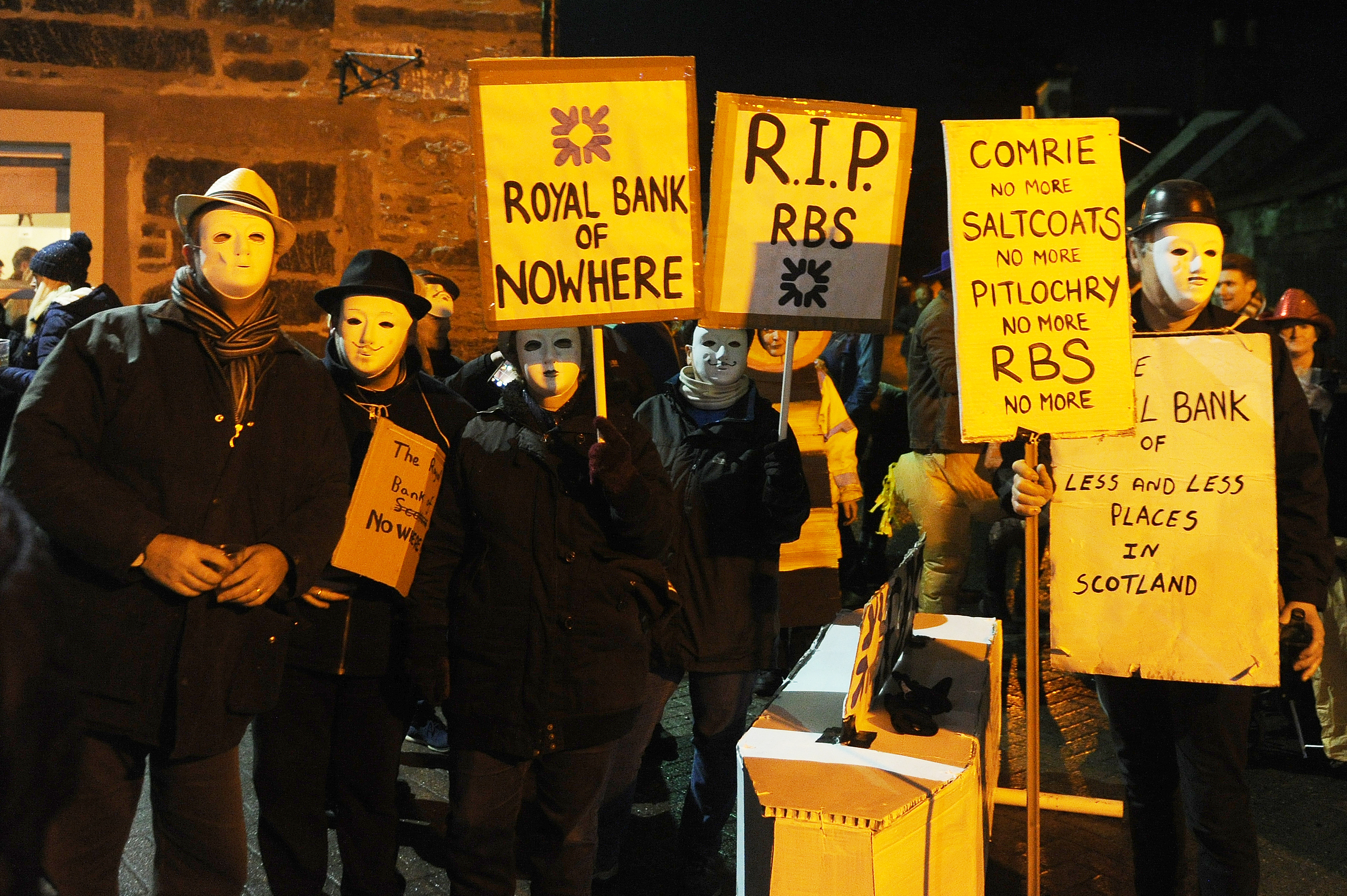 Locals in fancy dress staged a demonstration against RBS closures at the Flambeaux celebrations in Comrie at Hogmanay.