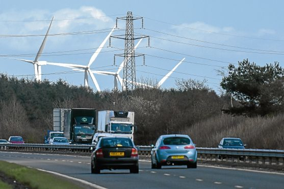Kim Cessford, The Courier - 19.04.16 - FOR FILE - pictured are the wind turbines near Cowdenbeath next to the A92 with electricity pylons in front - energy supply type generic pic