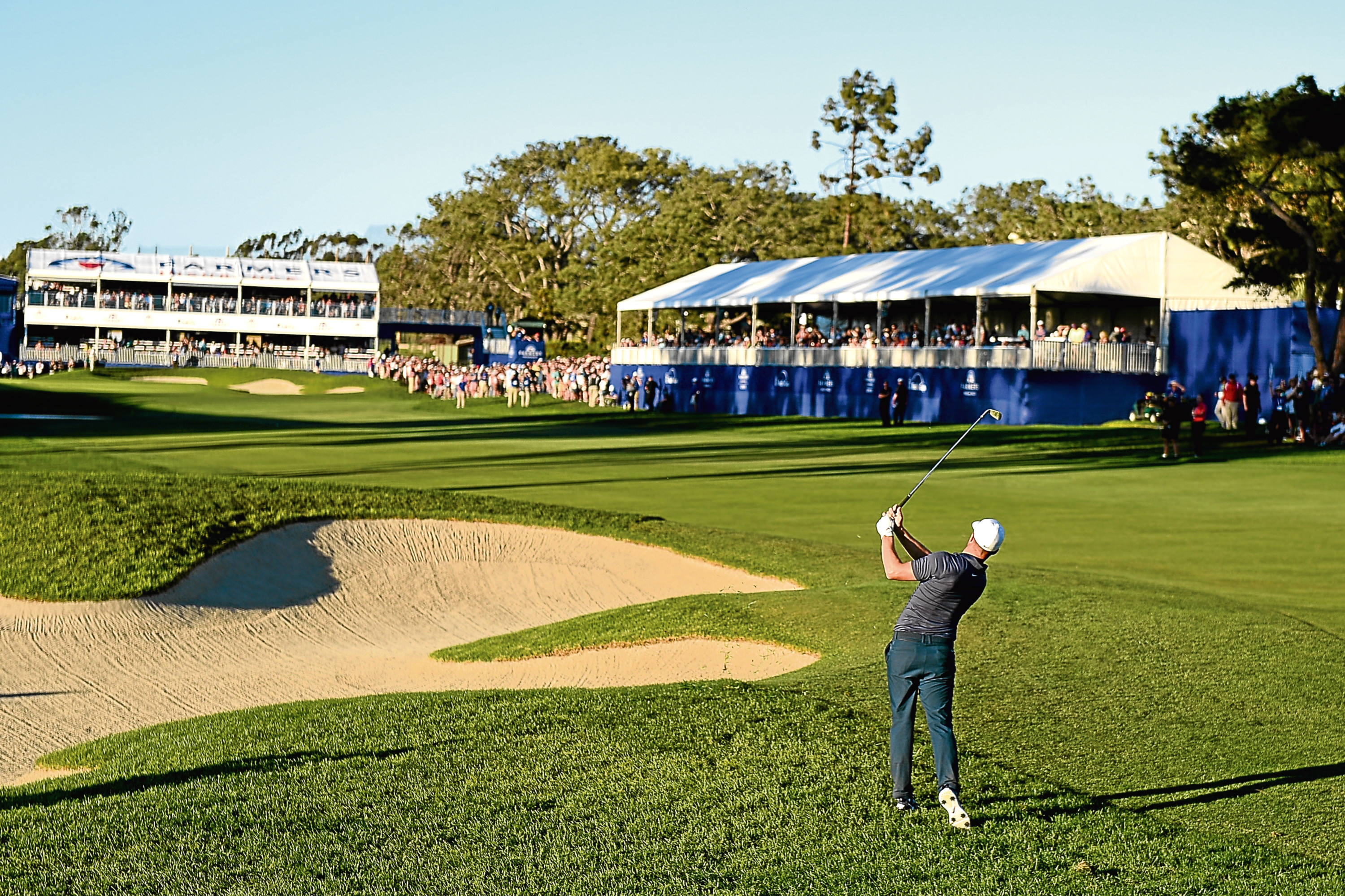 SAN DIEGO, CA - JANUARY 28:  Alex Noren of Sweden plays a shot from a bunker on the 18th hole during the second playoff in the final round of the Farmers Insurance Open at Torrey Pines South  on January 28, 2018 in San Diego, California.  (Photo by Donald Miralle/Getty Images)
