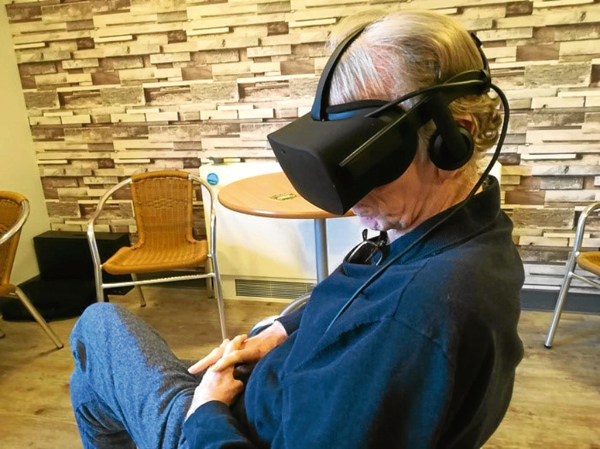 An older person trying a virtual reality headset.