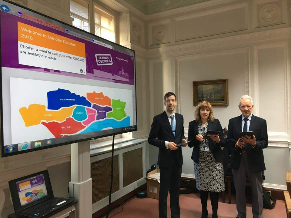 Council leader John Alexander, executive director of Neighbourhood Services Elaine Zwirlein and outgoing Citizen of the Year George Roberts launching Dundee Decides.