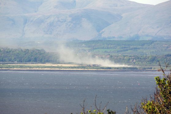 Dust from the ash lagoons was dispersed by the wind.