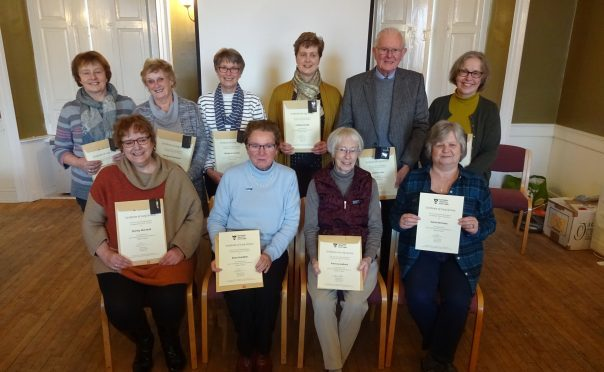 Some of the volunteers at Falkland Palace with their certificates.