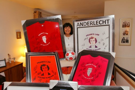 Mrs Kopel with just some of the shirts to be auctioned off.