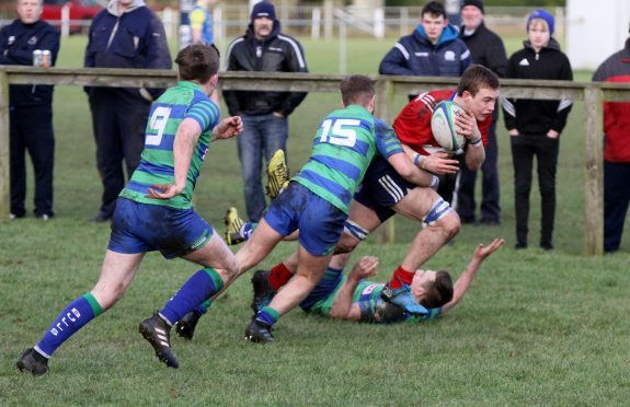 Andrew Steven charges through to score Howe's opening try in their 17-11 win over Hamilton.