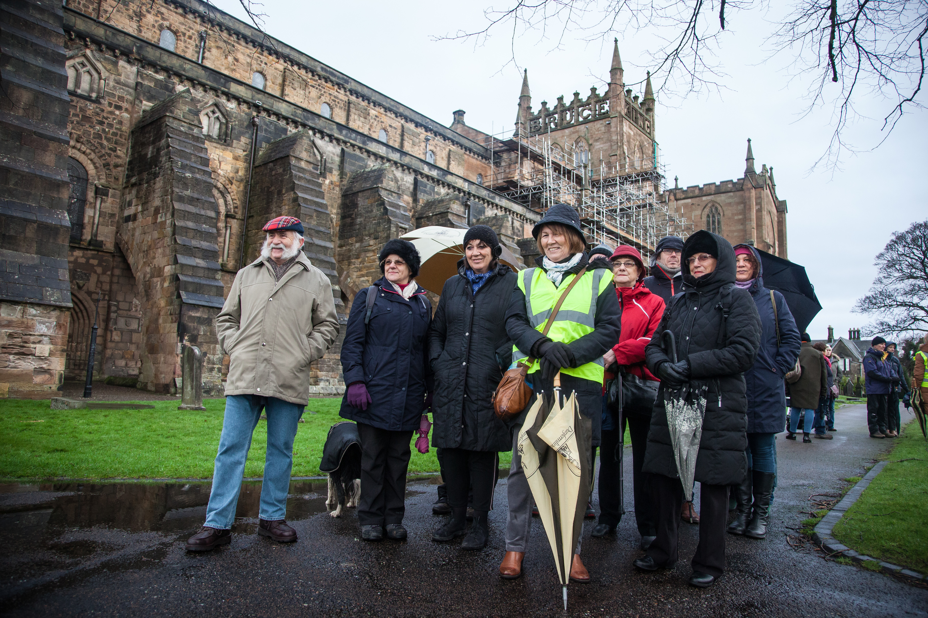 Guide Elaine Campbell pauses at Dunfermline Abbey as she leads a historical guided walk in Dunfermline