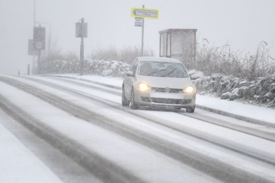 A car makes its way through the snow during the Beast from the East.