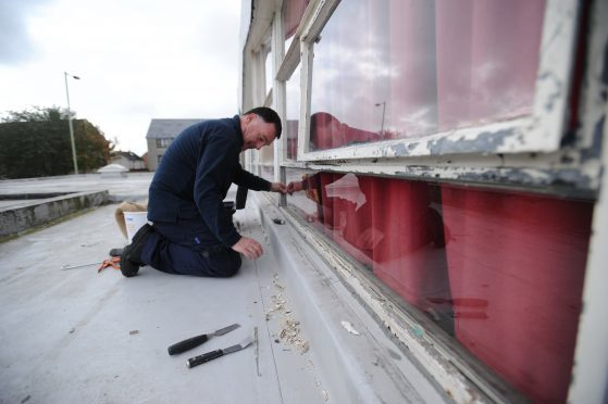 Repairing damage caused by vandals at St Luke's and St Matthew's RC Primary School in 2016.