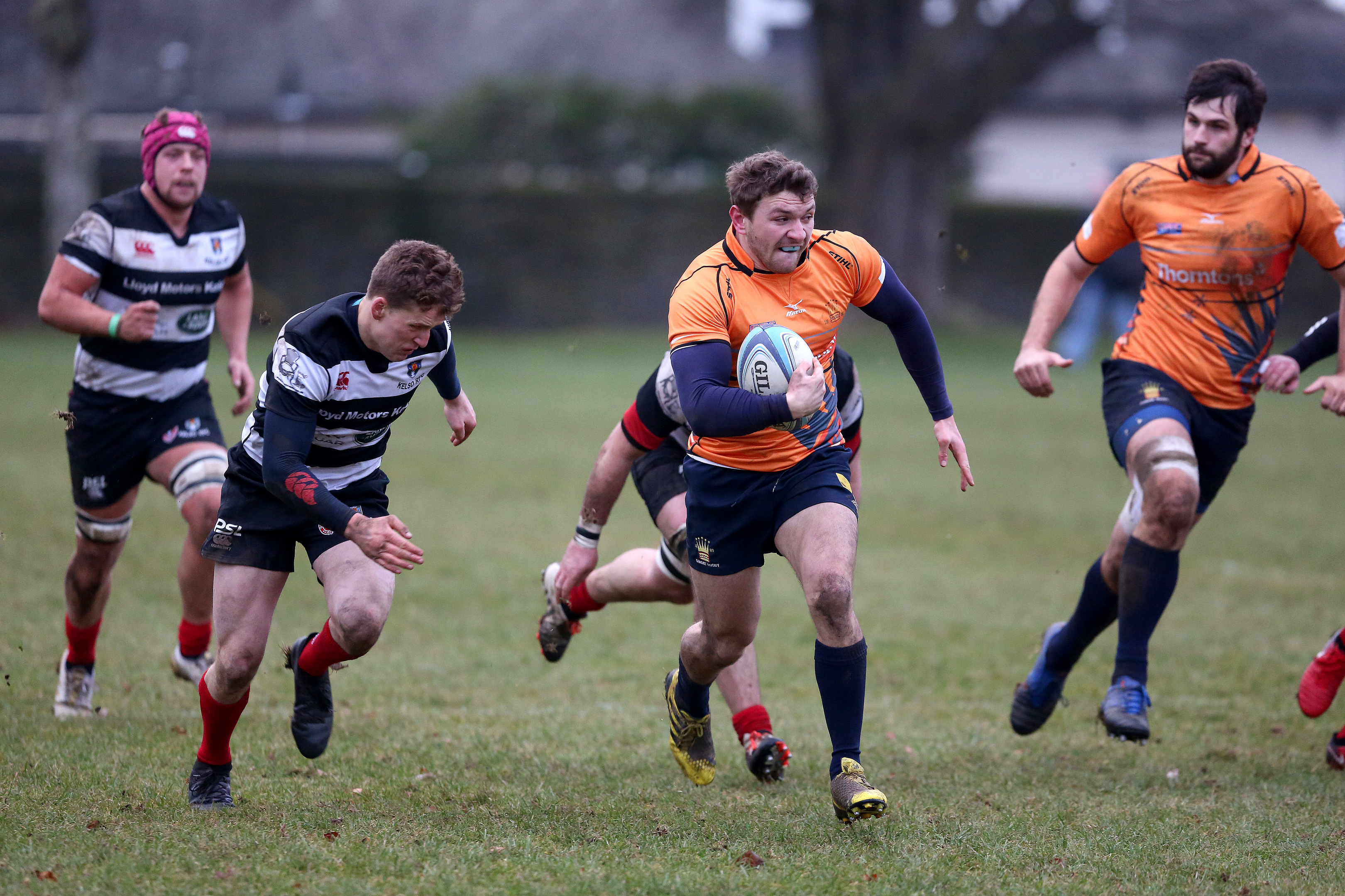 Neil Herron makes a rare clean break for Dundee High in their defeat to Kelso.