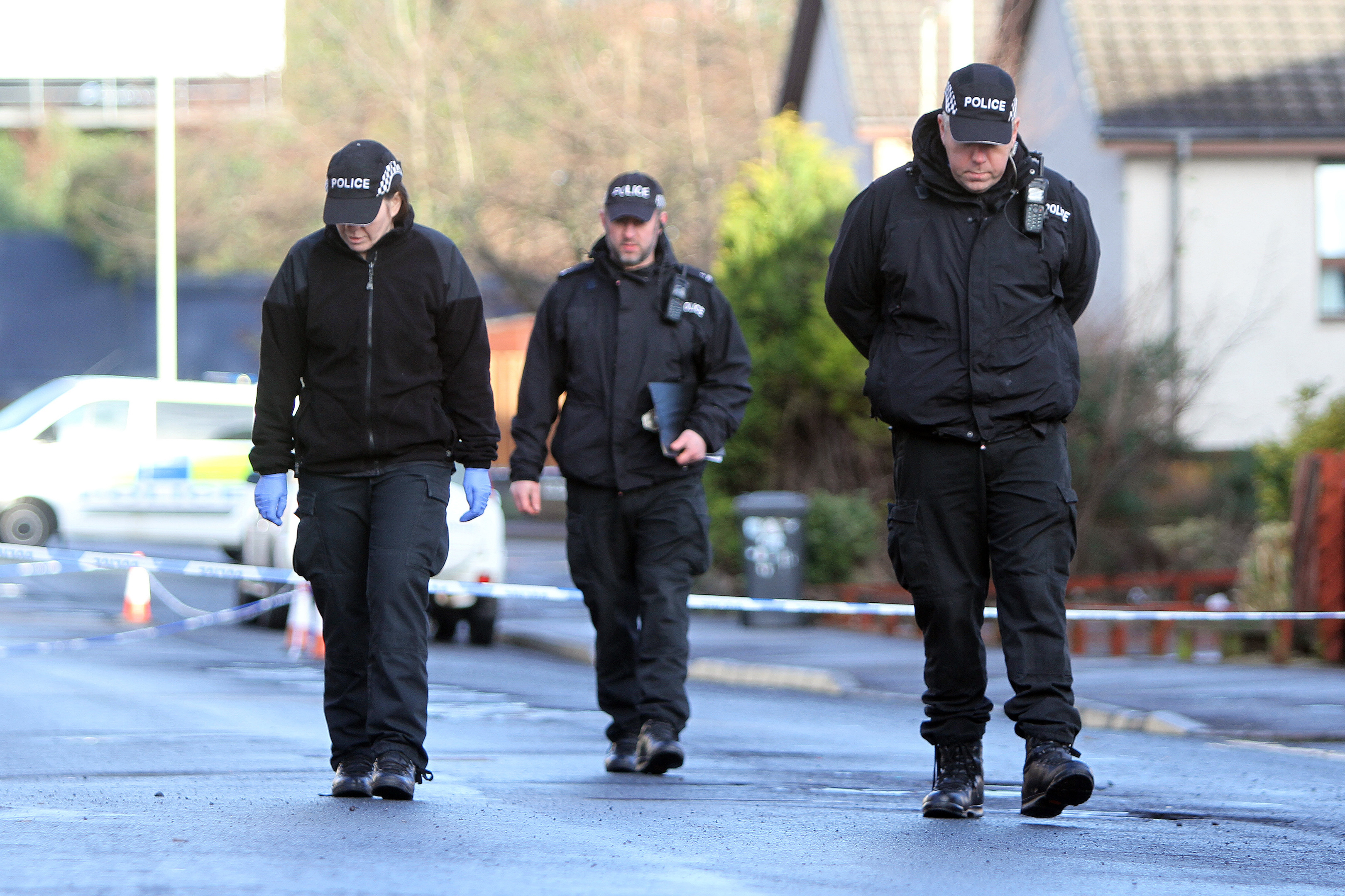 Police look for clues on Mains Road.