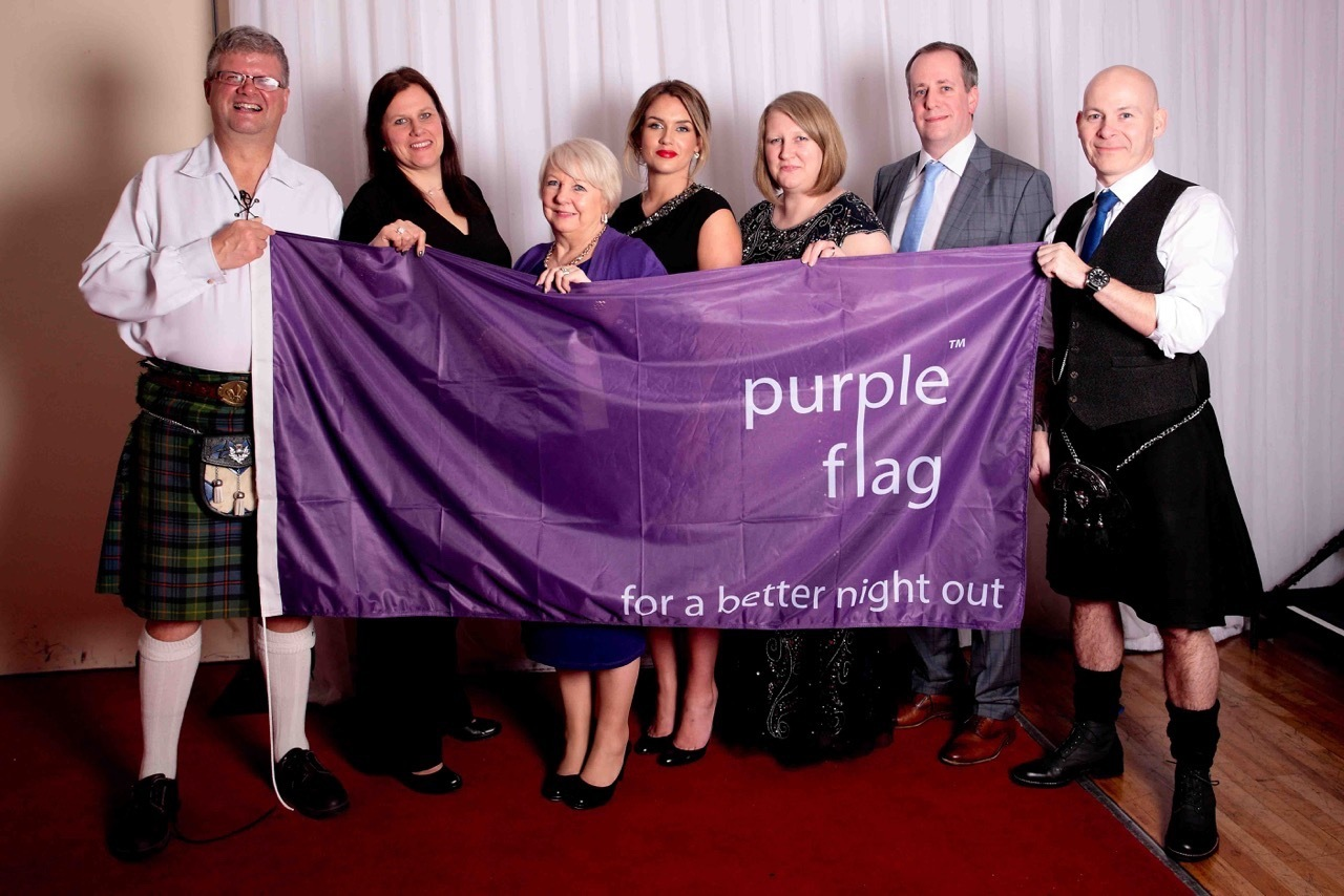 Dunfermline Delivers celebrate the purple flag award.